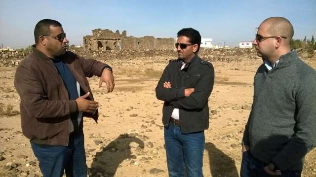 Umm al-Jimal Project team member Muaffaq al-Hazza (left) discusses the history of the site with SCHEP team members Abdelrahman al-Nasarat (center) and Ragheb Fityan (right). SCHEP makes regular visits to partner sites throughout Jordan to assess needs and community involvement. Photo by Glenn J. Corbett.