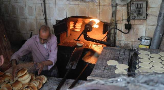 Subsidized bread like the loaves produced by this bakery in the Jabal al-Nadhif neighborhood of Amman is a critical staple for many Jordanians, who consume an estimated ten million loaves every day.