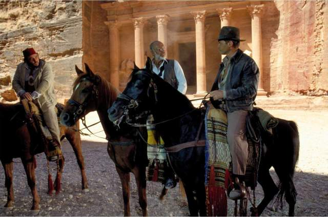 "Screenshot from the 1989 film ""Indiana Jones and the Last Crusade"" with the Treasury in Petra in the background (Paramount Pictures)"
