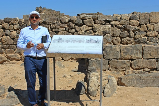 Jehad Horoun with new interpretive panels at the Umm el Jimal site near Mafraq