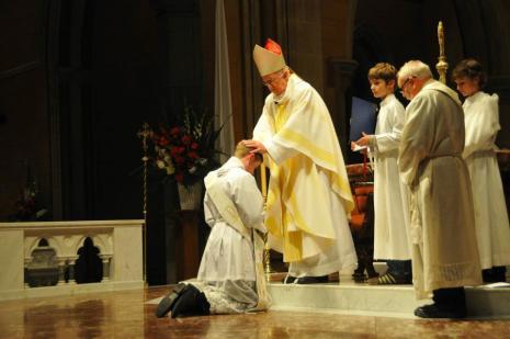 Bishop Peter Connors lays hands