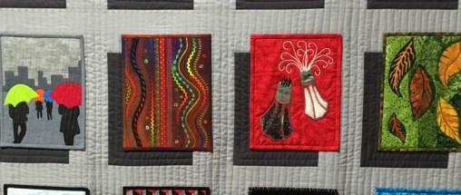 A row of journal quilts