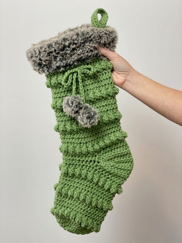 Learn how to make an easy crochet Christmas stocking that's perfect for the holidays and great for selling at holiday markets! Free crochet pattern with video.