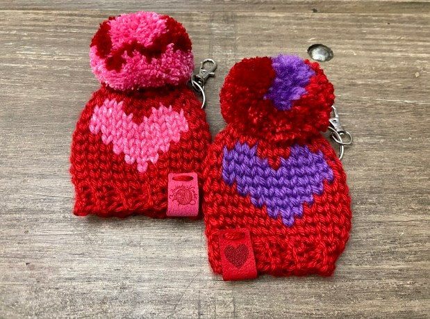 Learn how to make this adorable heart crochet beanie keychain, free crochet pattern by Buddy Luvs Crochet, just in time for Valentine's day!