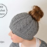 Free Crochet Pattern - Crochet Cabled Messy Bun Hat (Adult Sizes) (video tutorial included) by A Crocheted Simplicity