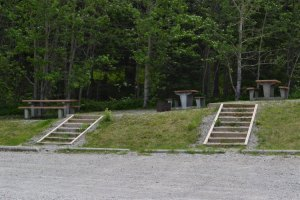 stairs into grass up hill to picnic tables