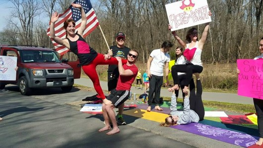 Cheering on Little Rock marathon runners this afternoon, acro-style! 12821576_1135037153182394_12728