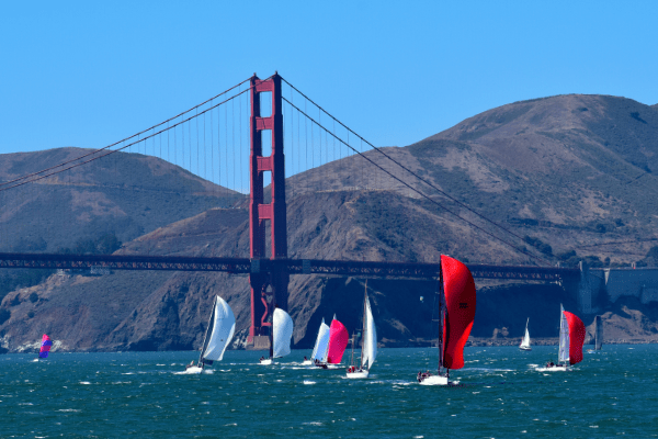 Sailboats racing under Golden Gate Bridge