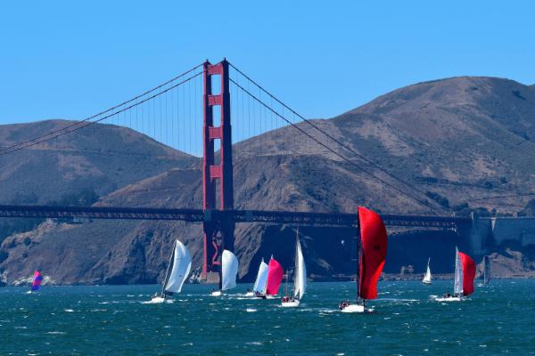 Sailboats racing under Golden Gate Bridge
