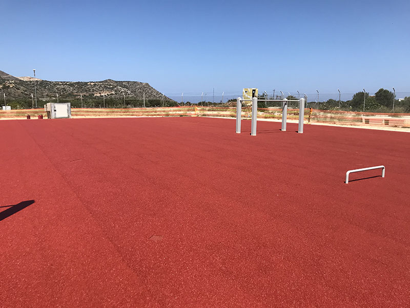 Supply and installation of wet poured athletic floor in the US Navy Base in Souda