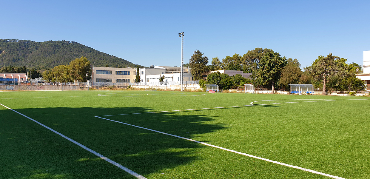 Synthetic turf and sports equipment at the Ialyssos High School football field