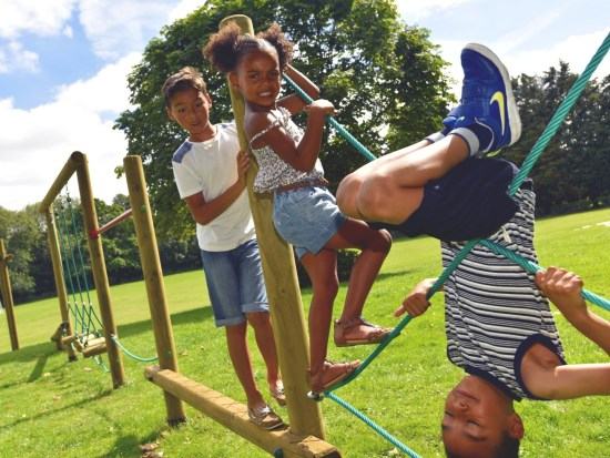 Children playing on an adventure trim trail