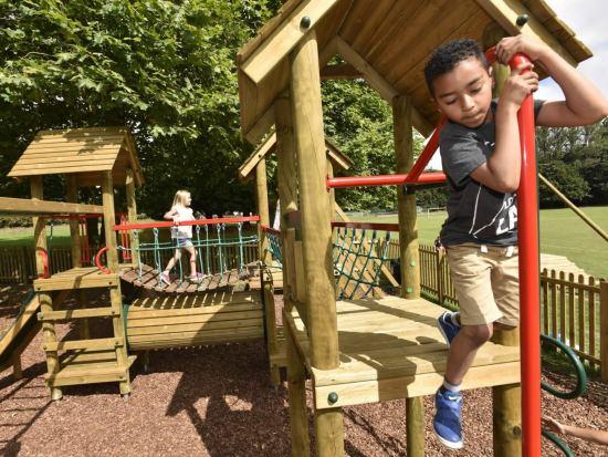 Boy climbing a fireman's pole