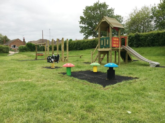 Waxham 1 play tower with trim trail balance weave in the background at Yaxley near Perterborough