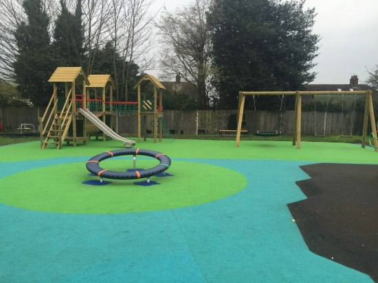 Group Swing and a Litcham 4 Play Tower in Green and Blue Wet Pour at Hertford Heath Play Area