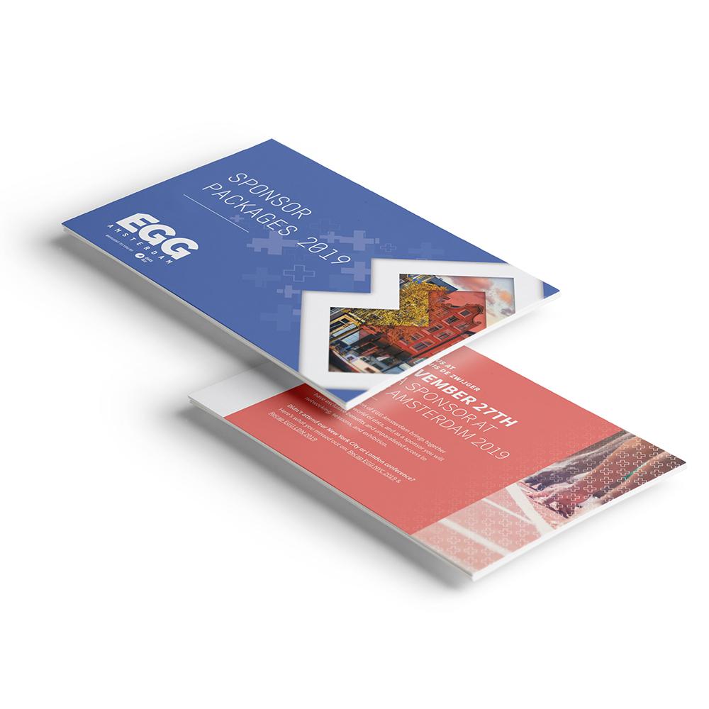 Dit is een afbeelding van het sponsorboekje voor EGG Amsterdam 2019 #EGGAMS2019 dat in Pakhuis de Zwijger werd gehouden. We zien twee platen van het sponsorboekje in de huisstijl van EGG Amsterdam, bestaande uit drie Amsterdamse kruizen en witte logo van EGG Amsterdam. Daaronder het logo in wit van Dataiku. De stijl van EGG Amsterdam is volledig ontwikkeld door Activates merkversterkend reclamebureau uit Sassenheim in opdracht van Dataiku en Karin Heppener van Heppener makes it happen!