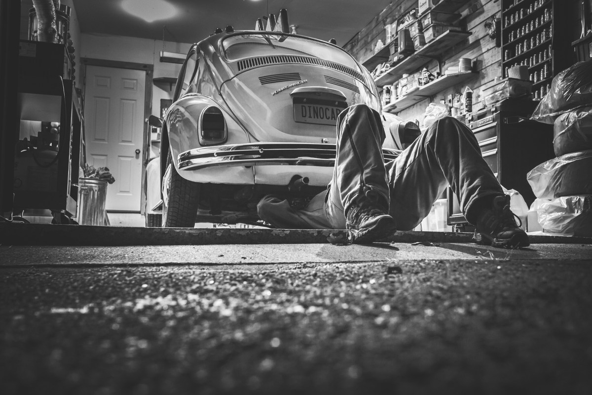 man underneath the car fixing something