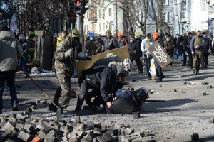A police officer attacked by protesters during clashes in Ukraine.