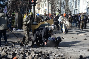 A_police_officer_attacked_by_protesters_during_clashes_in_Ukraine_Kyiv._Events_of_February_18_2014
