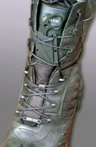 LDK knife laced into boot. The hole in the handle allows a one-finger draw when it is laced flat like this and a proper grip can't be obtained.