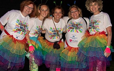 AMS STAFF take part in Midnight Walk which helps raise more than £100,000 for St Luke's Hospice
