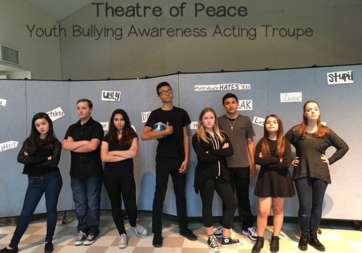 Photo of Theatre of Peace Bullying Awareness Acting Troupe, a division of the non-profit Act Like You Matter, getting into character for the performance part of Workshop for a middle school.
