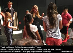 Photo of Theatre of Peace playing community-building games with students at a school. Part of Act Like You Matter: Anti-Bullying Empowerment Workshops.
