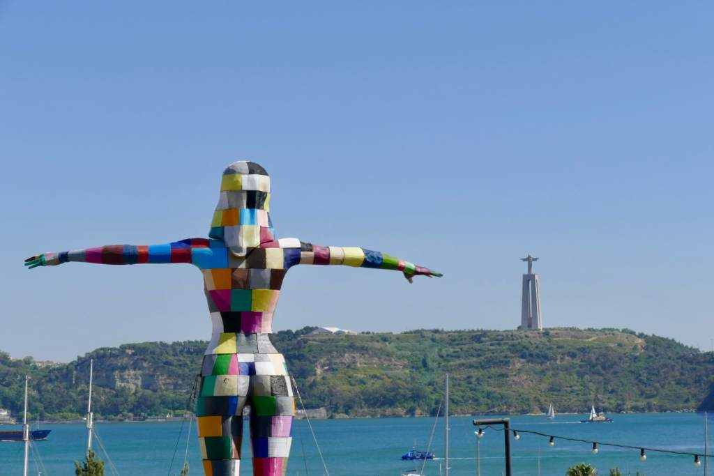 Lisbon river statue christ