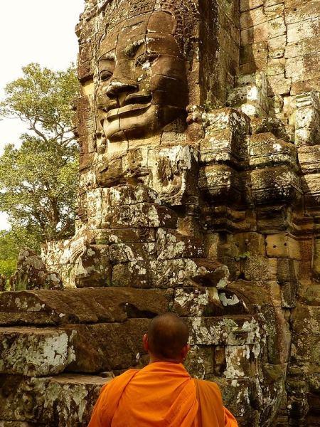 Monk looking at Bayon faces