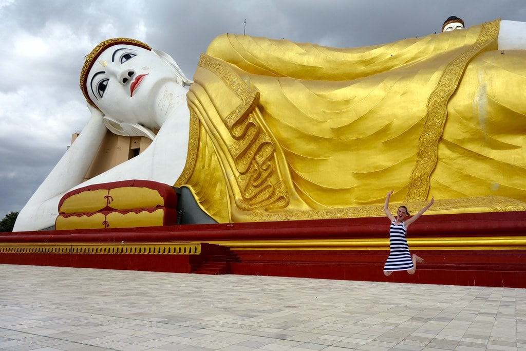 Jumping in front of lying buddha