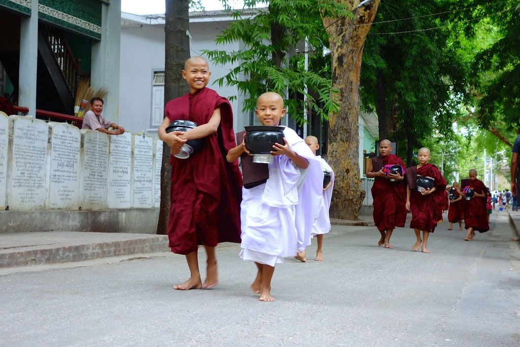 Two young monks with food bowl