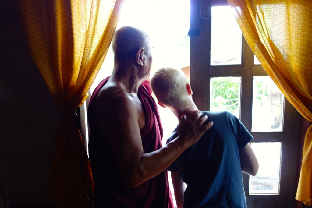 Monk showing my son something outside his house