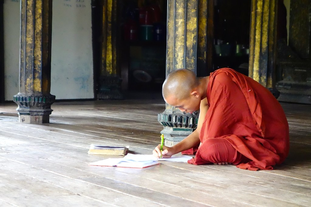 Monk writing and studying
