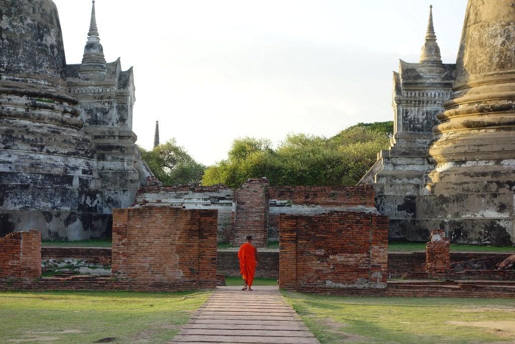 Thai Monk walking towards temple