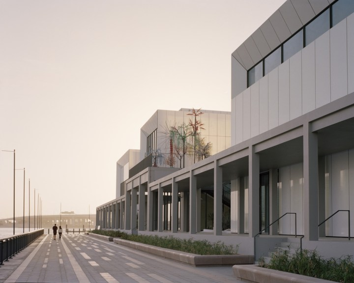 The colonnade provides an interface between the Centre and waterfront promenade. Photo credit Rory Gardiner. Courtesy of Jameel Arts Centre, Dubai