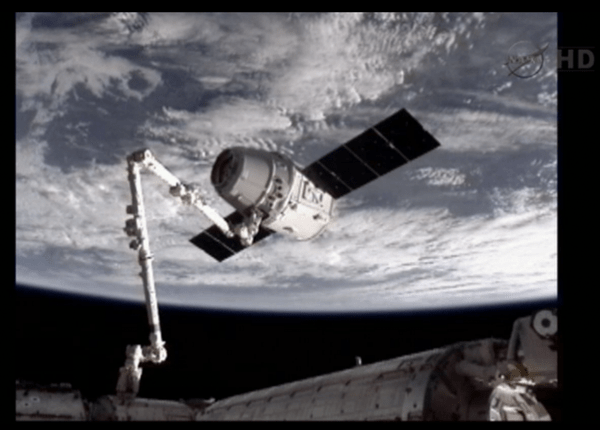 Capture Confirmed SpaceX Dragon Links with ISS Arm
