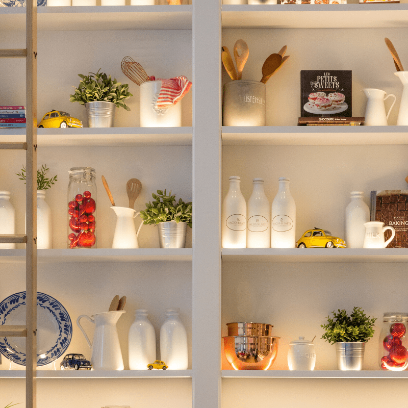open white shelves with bottles and dishes