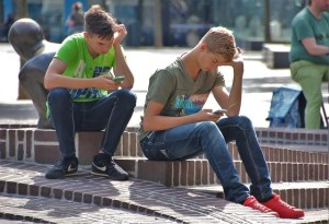 Boys using phones -- to talk to each other? Or not?