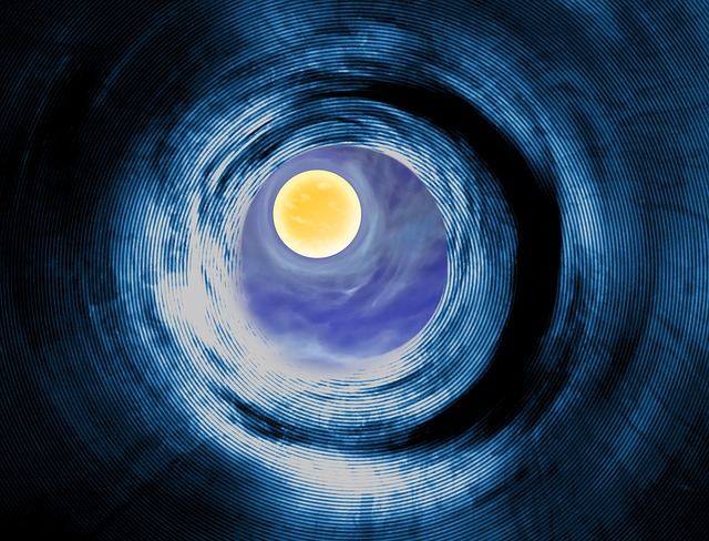 Moon seen through swirl representing bending of time and space