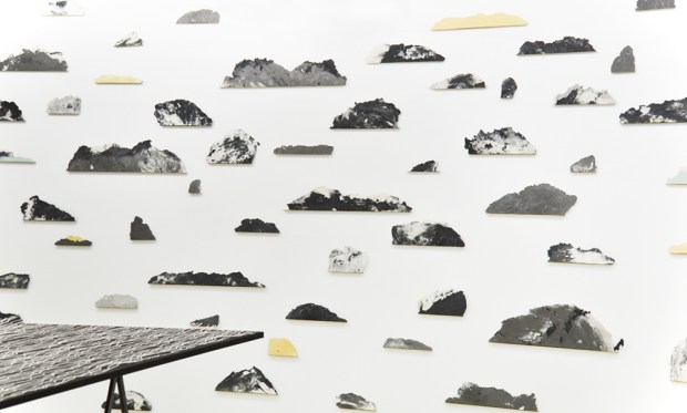 Archipelago, 2019, Installation made of individual islands, paper pulp, graphite, natural earth pigments, brass shelf, various sizes