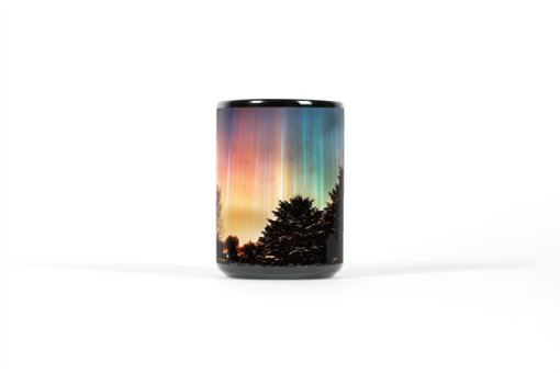 Center view of black mug with colorful light pillars