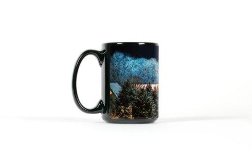 Left view winter scene on black mug
