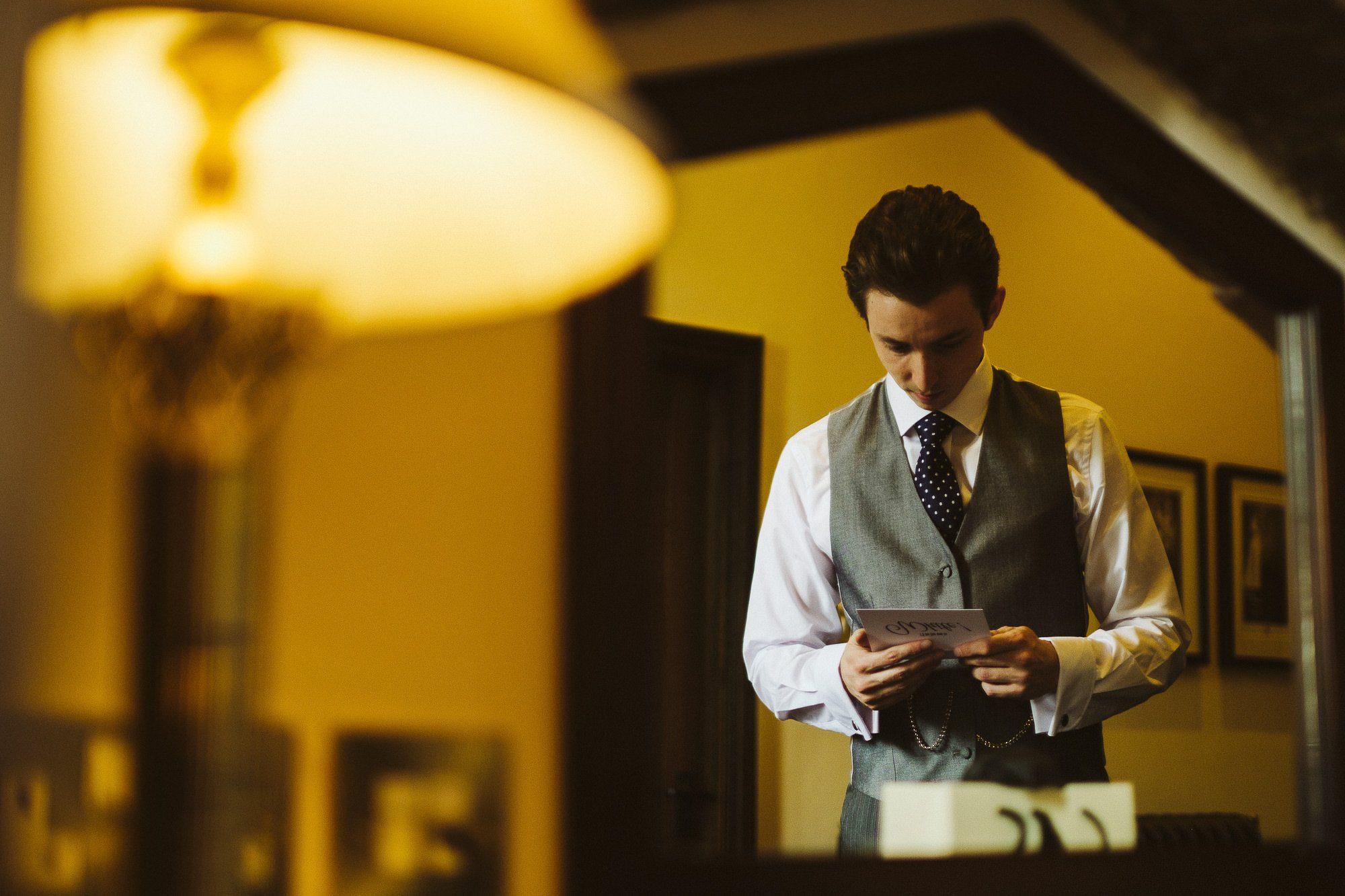 groom getting ready peckforton castle