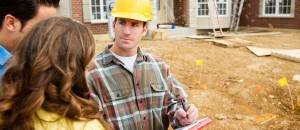 A contractor trying to get homeowners to sign off to begin construction on their home.