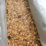 A slab of uncut cashew date bars
