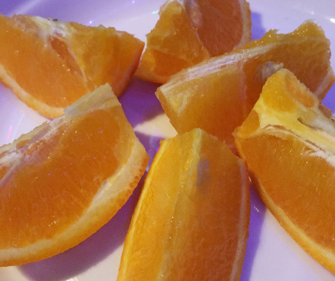 A plate of orange wedges at Hungry Eye Restaurant and Bar