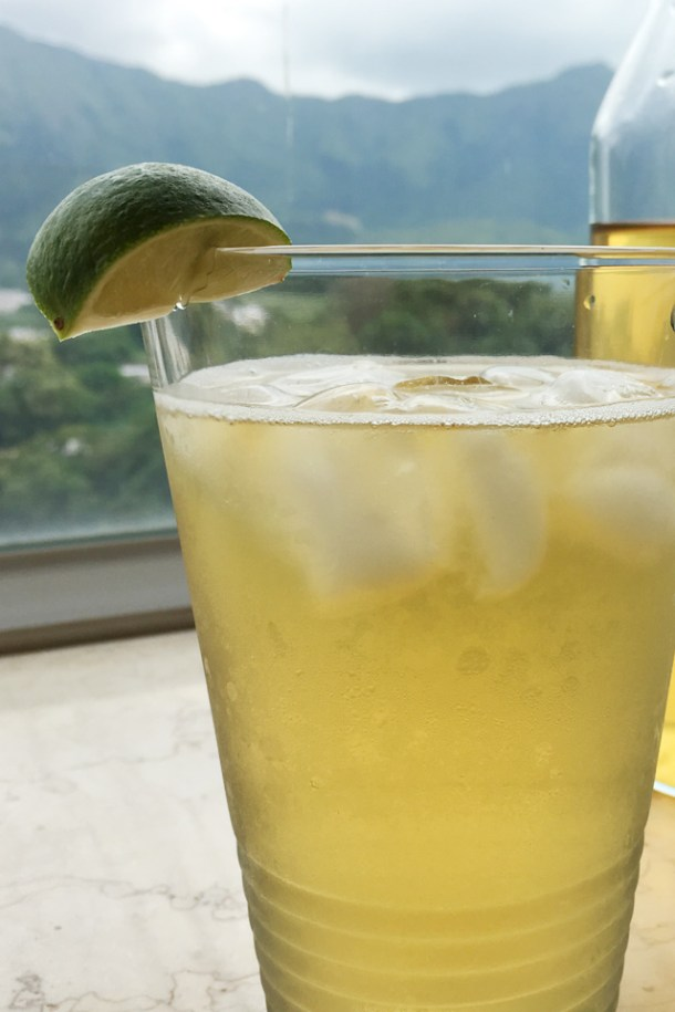Close-up of a glass of Cold Brewed Tea with ice cubes and a lime wedge garnish