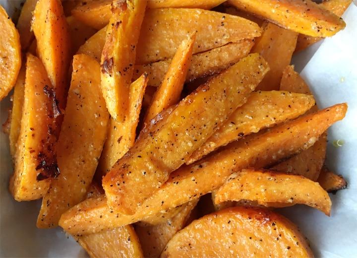 Several orange sweet potato wedge fries