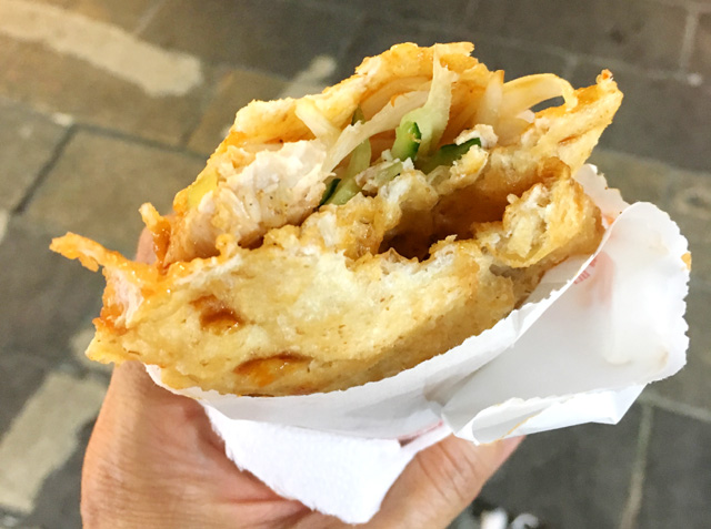 An egg wrap containing roast pork and vegetables - eat in Taipei