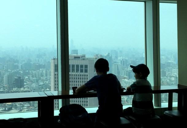 Sitting by the window in Starbucks 101 in Taipei